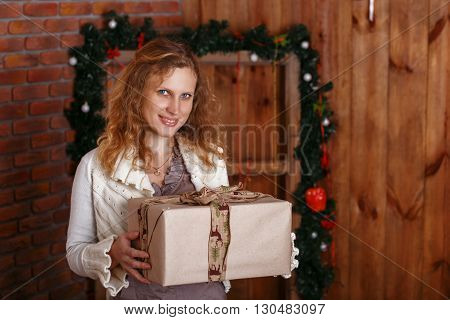Portrait Of A Beautiful Woman In The Interior With Christmas Decorations.