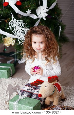 Portrait Of Cute Little Girl Among Christmas Decorations