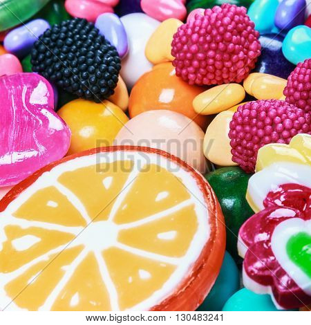 multicolored lollipops candy and chewing gum background. Shallow depth of field and soft focus