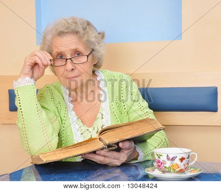 Senior Lady Holding A Book