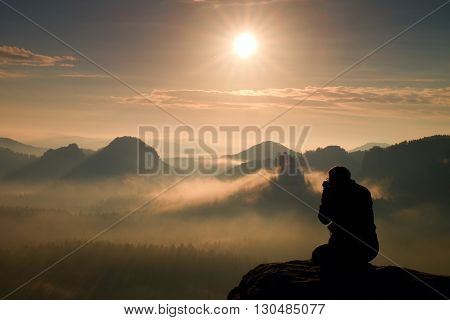 Photograph Takes Photos Of Daybreak Above  Heavy Misty Valley. Landscape View Of Misty Autumn Mounta