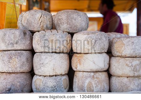 View of Italian delicious cheese exposed in the street market