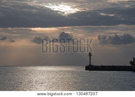 Sunrise at Puerto Juarez Harbor Seawall Jetty at Cancun Mexico