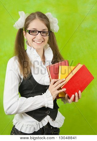 Schoolgirl In Glasses With Books