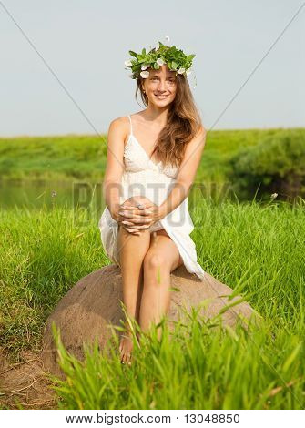 Girl Sits On Field Stone