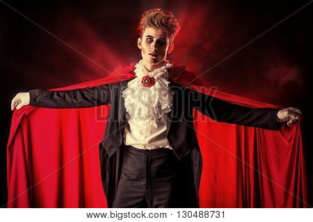 Bewitching handsome male vampire. Halloween. Dracula costume.