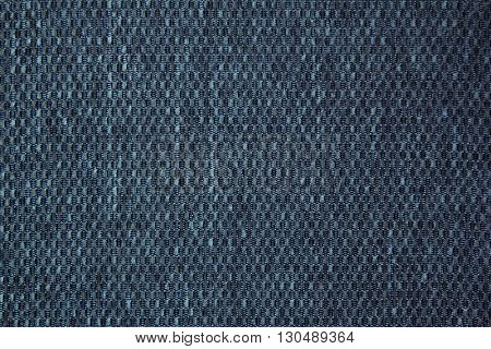 Chess texture fluffy cloth. Dark blue background. Fabric background.