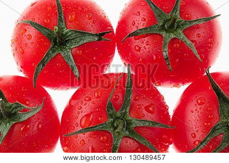 Macro tomatoes on a white background. Isolated. Tomato pattern. Food background. Macro. Texture.