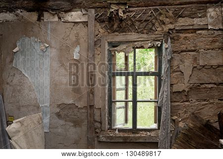 Old Abandoned Wooden House With A Broken Window, Close-up.