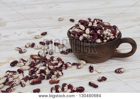 Red and white Haricot beans on wooden background