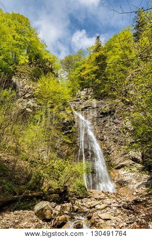 Sutovsky Waterfall In Spring Forest Under Blue Sky