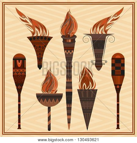 Set of ornamental blazing torches on the sandy background. Elements of greek ornament, fire for design flyers, invitations, theme evenings. Vector illustration