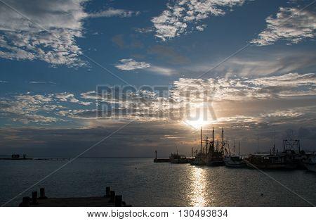 Sunrise over Puerto Juarez Boat Dock Pier Jetty Seawall in Cancun Bay Mexico