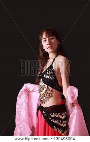 portrait of belly dancer on black background
