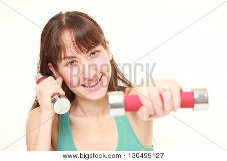 woman doing dumbbll exercise on white background