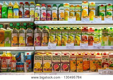 BANGKOK THAILAND - NOVEMBER 18 2013 : Shelves with fruit juices in a supermarket Siam Paragon in Bangkok Thailand.