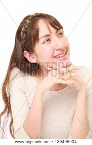 portrait of young woman dreaming at her future on white background