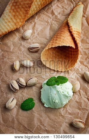 Scoop Of Pistachio Ice Cream And Waffle Cone