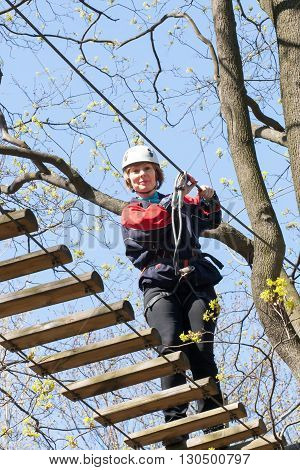 The Girl Climbs Obstacles Of Rope Park