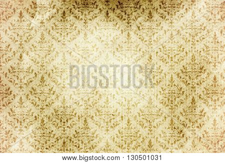 Aged paper background with old-fashioned floral patterns. Natural old paper texture for the design.