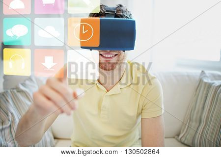 technology, gaming, media, entertainment and people concept - happy young man in virtual reality headset or 3d glasses with computer icons at home