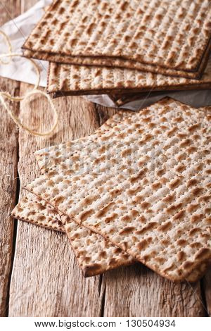 Traditional Jewish Kosher Matzo For Passover Macro On A Table. Vertical