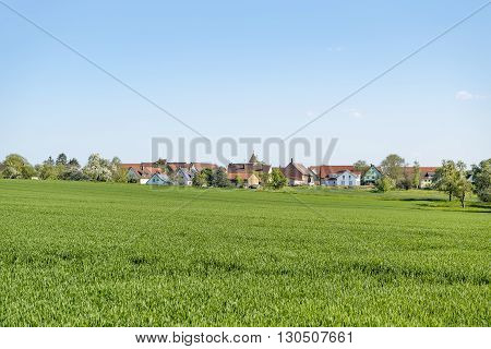 sunny illuminated idyllic rural springtime scenery around a small village in Hohenlohe a district in Southern Germany