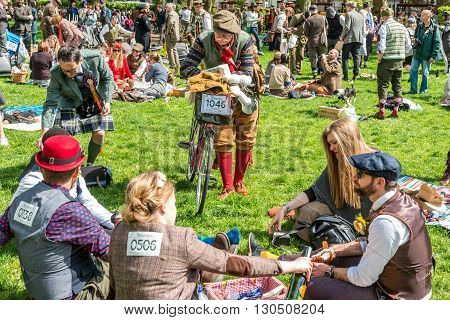 London United Kingdom - May 14 2016: Tweed Run (bicycle ride with a style) at picnic near Albert Memorial in Kensington Gardens Hyde Park.