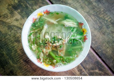 Hot cambodian broth glass noodles. Traditional khmer style soup.