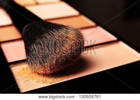 Makeup brush with blusher closeup