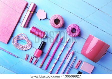 Pink colour flat lay composition on blue background, top view