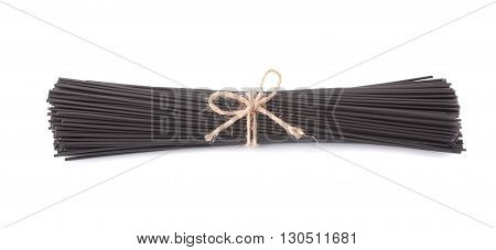 Black spaghetti with cuttlefish ink, isolated on white background