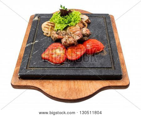 Grilled pork fillet with delicious vegetables on grill metal pan. Isolated on  white background.