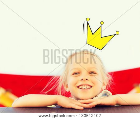 childhood and people concept - happy little girl on children playground with prinncess crown doodle over head