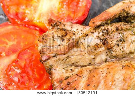 Grilled pork fillet with delicious vegetables on grill metal pan. Macro. Photo can be used as a whole background.