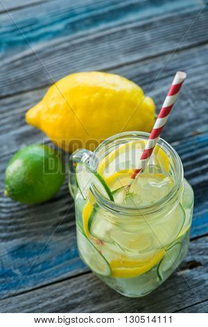 Jar With Infused Detox Water On Wooden Table