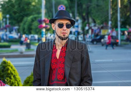 Zaporizhia/Ukraine- May 19, 2016: Stylish man in sunglasses and hat on celebration of national Ukrainian embroidered clothes, known as Vyshyvanka  Day