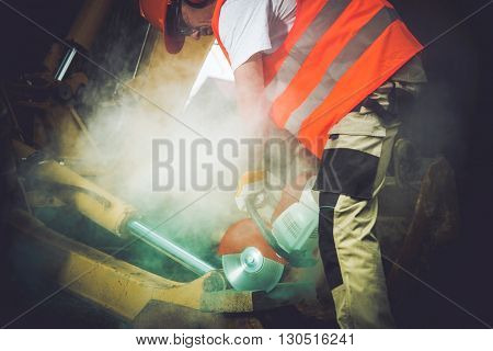 Construction Men Job. Caucasian Men with Stone Cutter at Work.