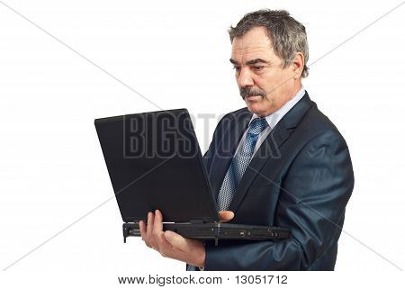 Serious Mature Manager Work On  Laptop