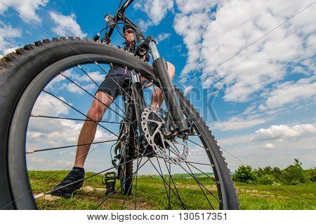 Riding Modern Mountain Bike. Mountain Bike Getaway Plan.