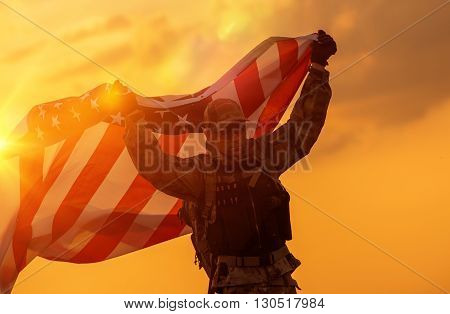 Soldier Celebrating Victory Running with Large American Flag. Trooper with the Flag.