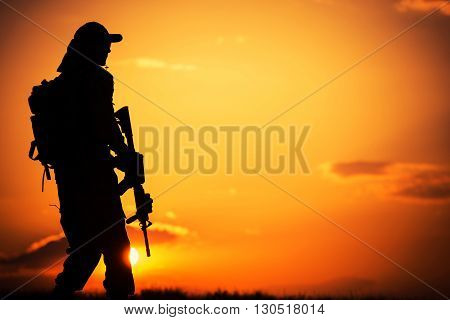 Call of Duty. Military Concept with Soldier with Assault Rifle on Duty During Sunset.
