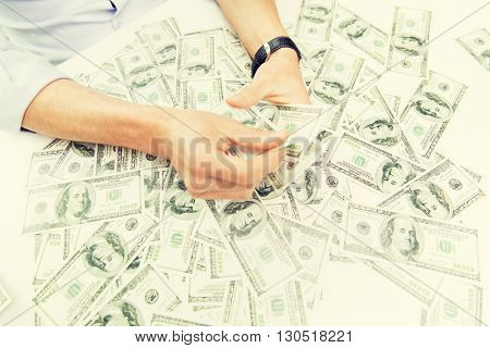 business, people, success and fortune concept - close up of male businessman hands with dollar money