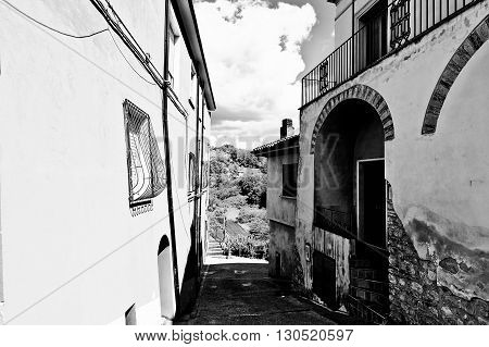 Narrow Street with Old Buildings in Italian City Retro Image Filtered Style