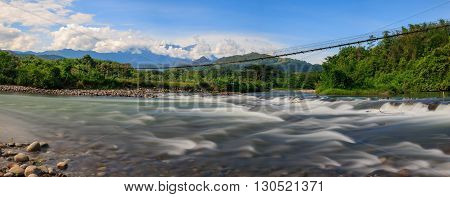 Panorama view ofScenic tropical landscape of Togudon Valley, Kota Belud, Sabah, Malaysia with Mount Kinabalu as background- image is blurry and for background purposes only.