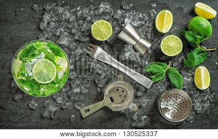 Cocktail drink making tools and ingredients. Cold drink. Mojito. Caipirinha. Vibrant colors