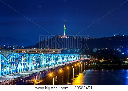 View of downtown cityscape at Dongjak Bridge and Seoul tower over Han river in Seoul South Korea.
