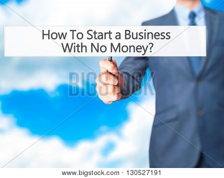 How To Start A Business With No Money - Businessman Hand Holding Sign