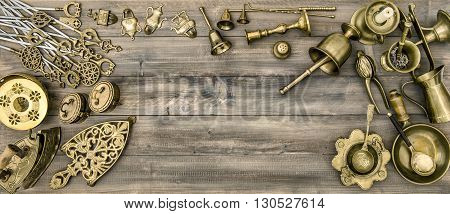 Kitchen table with antique tools and utensils. Vintage brass table ware