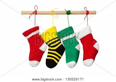 Stocking christmas socks. isolated on white background. Colorful xmas design decoration photography. red, yellow, green hanging knitted sock. Wooden plank